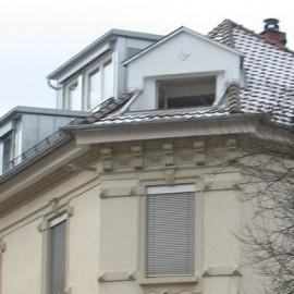 Sanierung des Dachgeschosses an einem Jahrhundertwende-Wohnhaus mit neuen Gauben und Dachterrassen